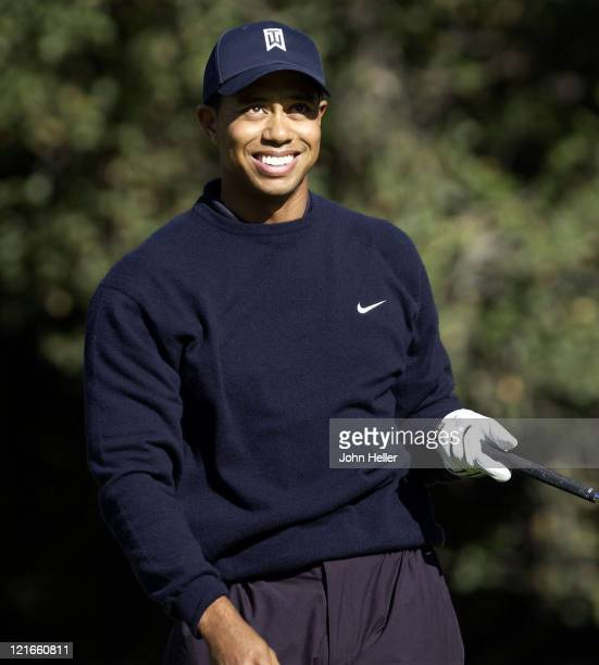 Still smiling after his drive ath the 6th tee Tiger starts the walk to his ball somewhere on the 6th fairway at the 2003 Target World Challenge...