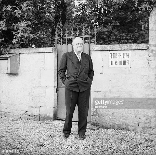 Still smiling, British Journalist Randolph Churchill stands outside a side entrance of General Charles DeGaulle's estate. De Gaulle refused to...