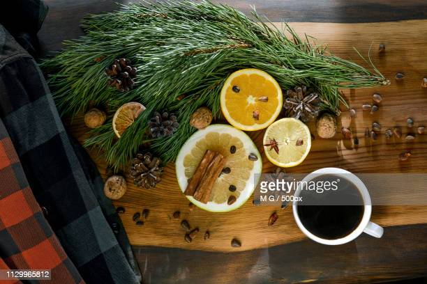 still-life new year, christmas - a cup of coffee, tangerines, lemons, walnuts, pine branches, - agulha parte de planta imagens e fotografias de stock
