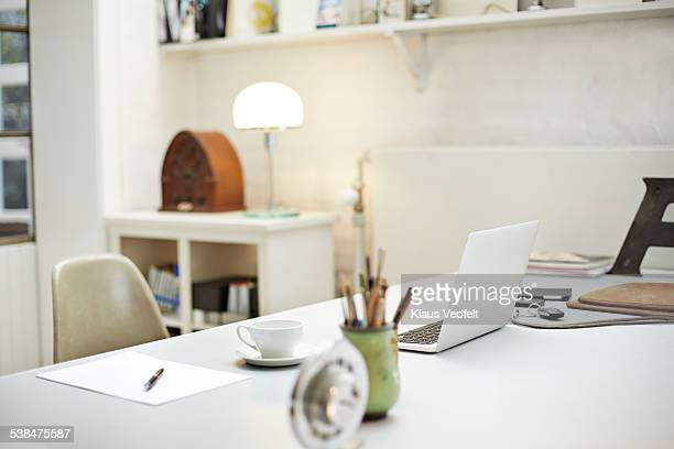 still-life of desk at small creative office - bureau stockfoto's en -beelden