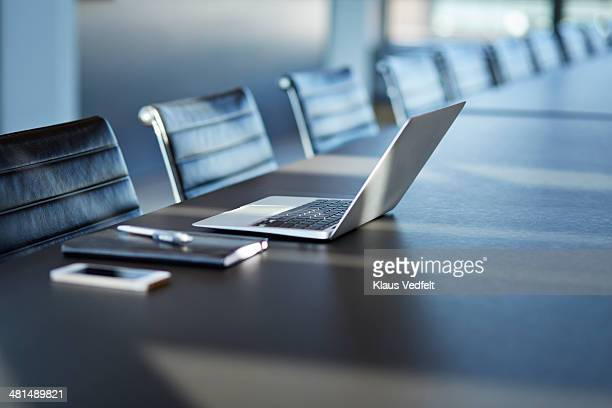 Still-life of laptop in stylish conference room