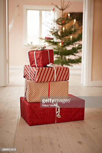 still-life of stack of christmas presents - christmas gifts stock photos and pictures