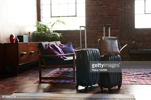 still-life of suitcases and shoulder bag, on the floor of cool holiday apartment - black purse stock pictures, royalty-free photos & images