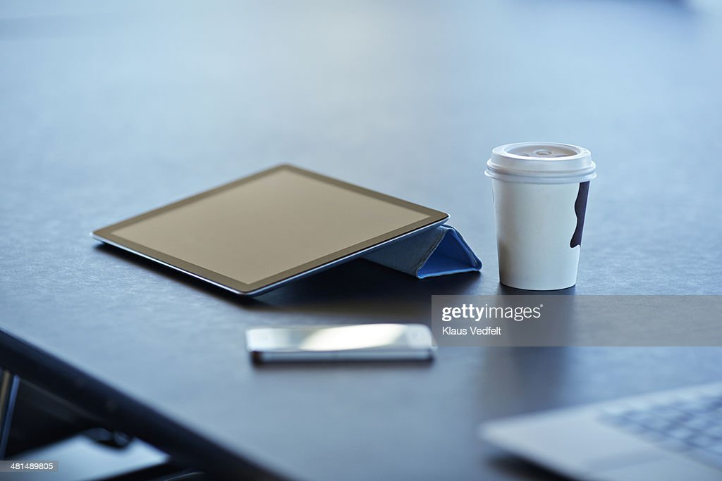 Still-life of tablet, to-go coffee & phone : Stock Photo