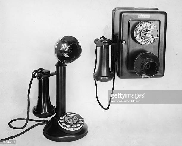 Stilllife of two oldfashioned telephones a candlestick phone and a wall mounted rotary phone 1920s