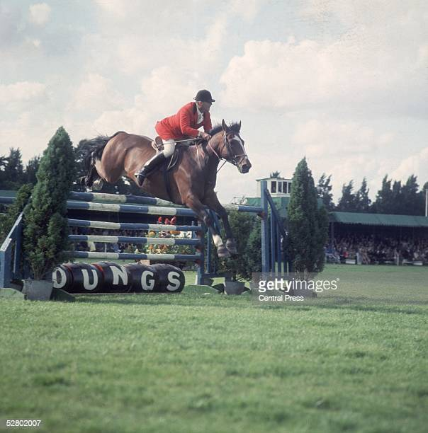 R Stillwell riding 'Aly' clears a jump at the Great London Horse Show on Clapham Common London September 1968