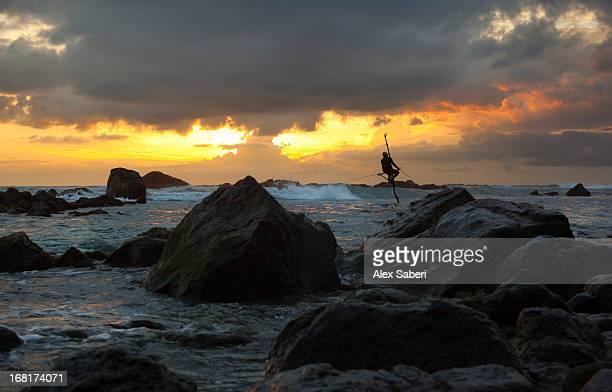 a stilt fisherman at sunset. - alex saberi fotografías e imágenes de stock