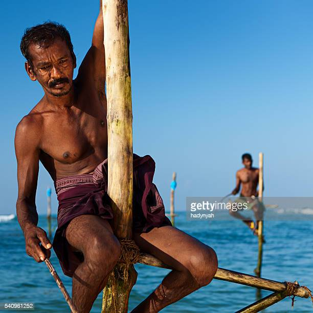 Stilt fishing - fisherman near Galle, Sri Lanka, Asia
