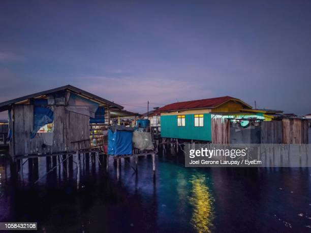 stilt houses against sky at dusk - mindanao stock pictures, royalty-free photos & images