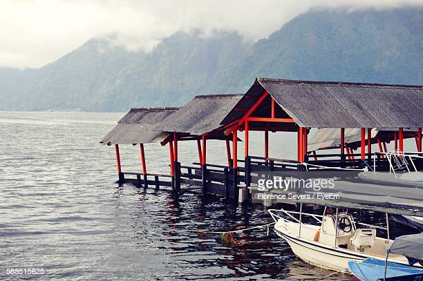 stilt houses and boats on lake at kintamani - kintamani district stock pictures, royalty-free photos & images