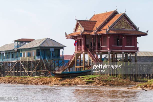 stilt houses in kampong phluk floating village - traditionally cambodian stock pictures, royalty-free photos & images