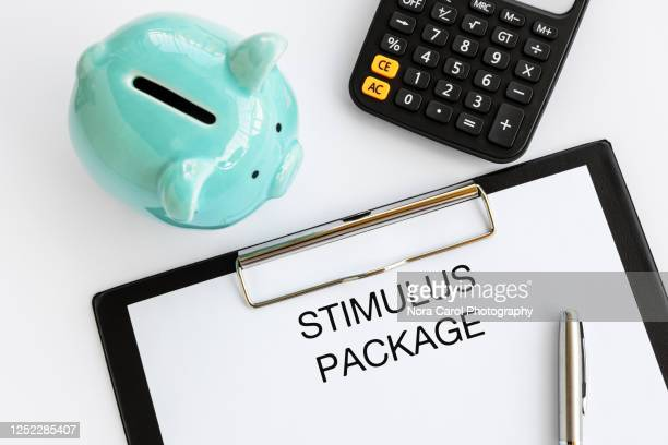 stimulus package text on clip board - economic stimulus stock pictures, royalty-free photos & images