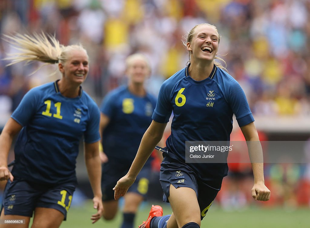 Stina Blackstenius #11 and Magdalena Eriksson #6 of Sweden celebrate their 1-1 (4-3 PSO) win over team United States during the Women's Football Quarterfinal match at Mane Garrincha Stadium on Day 7 of the Rio 2016 Olympic Games on August 12, 2016 in Brasilia, Brazil.
