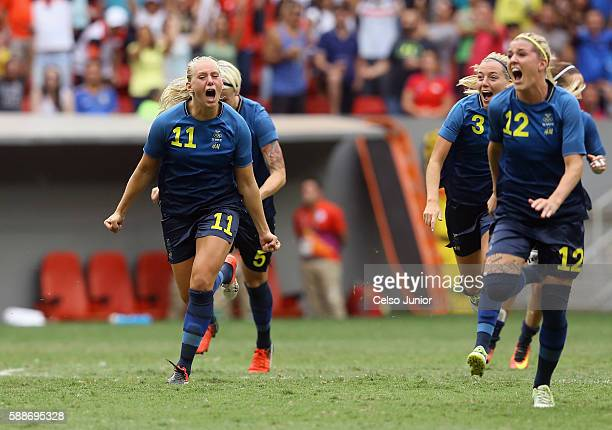 Stina Blackstenius and Olivia Schough of Sweden celebrates their 11 win over team United States during the Women's Football Quarterfinal match at...