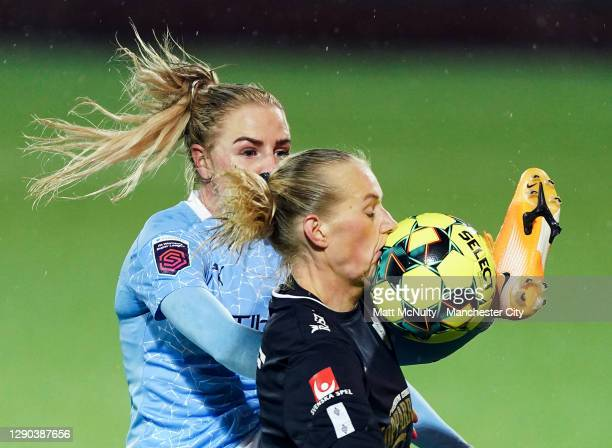 Stina Blackstenius of Gothenburg challenges Alex Greenwood of Manchester City during the UEFA Women's Champions League Round of 32 First Leg at...