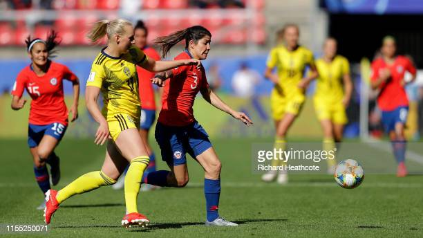 Stina Blackstenius of Sweden battles for possession with Carla Guerrero of Chile during the 2019 FIFA Women's World Cup France group F match between...