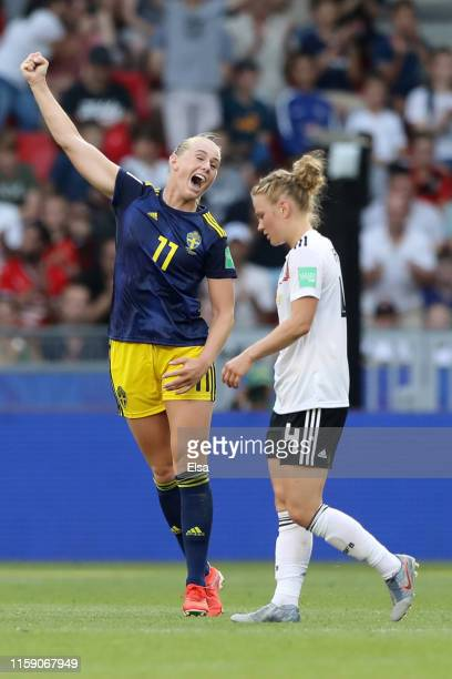 Stina Blackstenius of Sweden celebrates victory as Leonie Maier of Germany looks dejected after the 2019 FIFA Women's World Cup France Quarter Final...