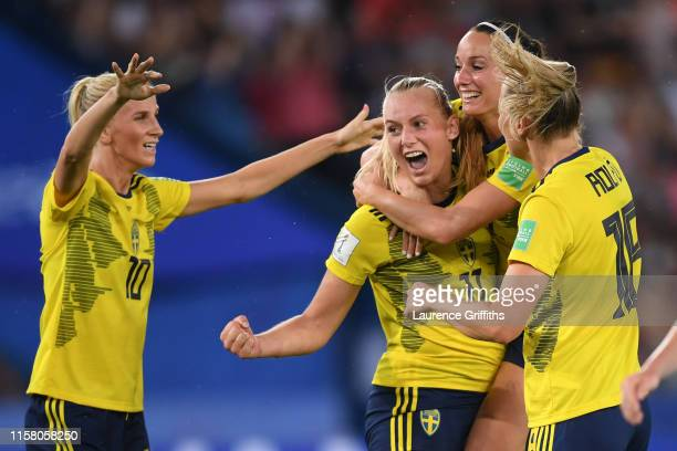Stina Blackstenius of Sweden celebrates with teammate Kosovare Asllani after scoring her team's first goal during the 2019 FIFA Women's World Cup...