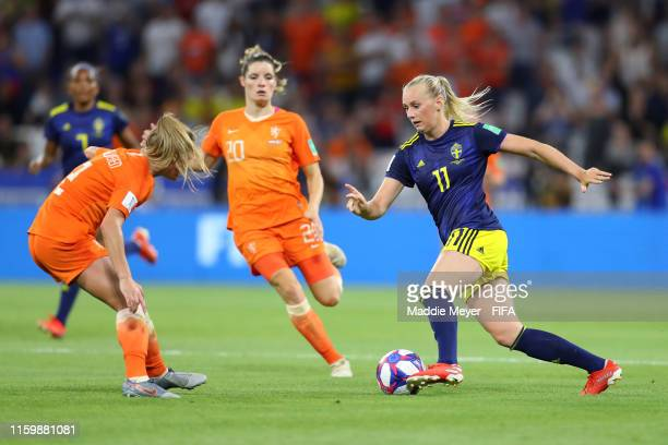 Stina Blackstenius of Sweden takes on Desiree Van Lunteren of the Netherlands during the 2019 FIFA Women's World Cup France Semi Final match between...