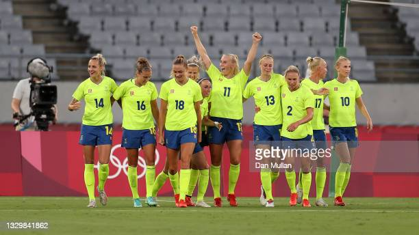 Stina Blackstenius of Team Sweden celebrates with team mates after scoring their side's second goal during the Women's First Round Group G match...