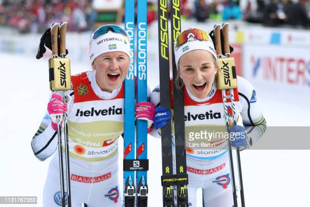 Stina Nilsson of Sweden and Maja Dahlqvist of Sweden celebrates following their victory in the Ladies' Cross Country Team Sprint during FIS Nordic...