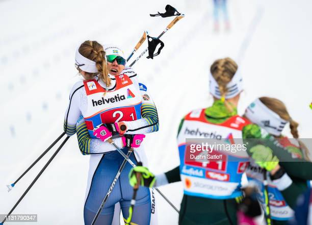 Stina Nilsson of Sweden and Maja Dahlqvist of Sweden hug in the finish area after a first place finish in the Cross Country Women's Team Sprint race...