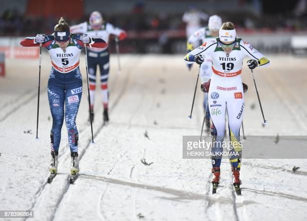 Stina Nilsson of Sweden competes to win the Ladies' Sprint Classic event in front of second placed Sadie Bjornsen of the US at the Ruka Nordic World...