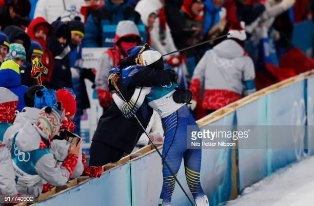 Stina Nilsson of Sweden gets a hug from head coach Rikard Grip during the Womens Individual Sprint Classic Finals on day four of the PyeongChang 2018...