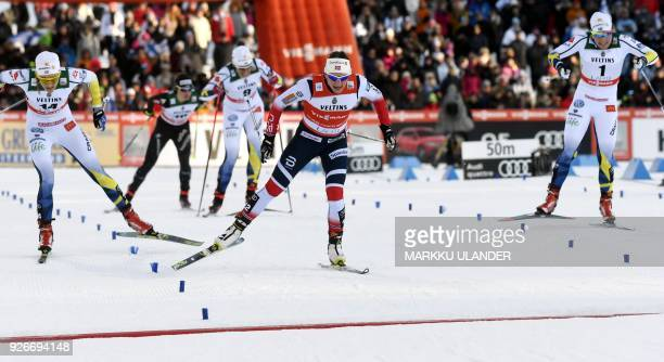 Stina Nilsson of Sweden Maiken Caspersen Falla of Norway and Hanna Falk of Sweden approach the finish line during the Women's CrossCountry Sprint...