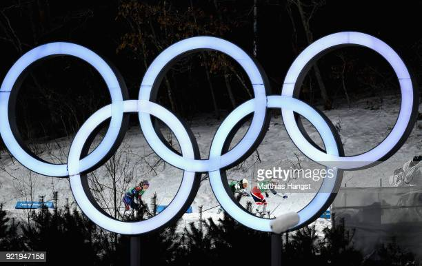 Stina Nilsson of Sweden Maiken Caspersen Falla of Norway and Jessica Diggins of the United States compete as they pass the Olympic Rings during the...