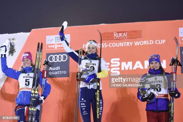 Stina Nilsson of Sweden poses on the podium with second placed Sadie Bjornsen of the US and third placed Yulia Belorukova of Russia after the Ladies'...