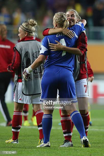 Stina Petersen and Emma Madsen of Denmark embrace each other after the 11 draw of the UEFA Women's EURO 2013 Group A match between Sweden and Denmark...