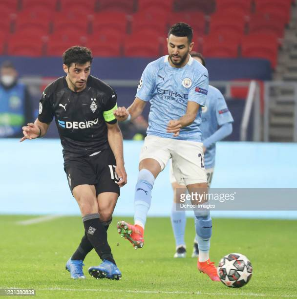 Stindl of Borussia Moenchengladbach and Riyad Mahrez of Manchester City battle for the ball during the UEFA Champions League Round of 16 match...