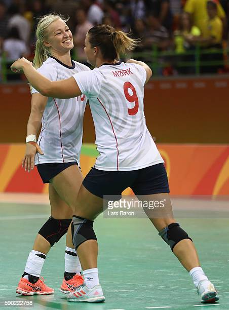 Stine Bredal Oftedal of Norway celebrates with Nora Mork of Norway after winning the Womens Quarterfinal match between Sweden and Norway on Day 11 of...
