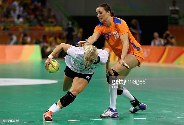 Stine Bredal Oftedal of Norway is chased by Yvette Broch of Netherlands during the Women's Handball Bronze medal match between Netherlands and Norway...