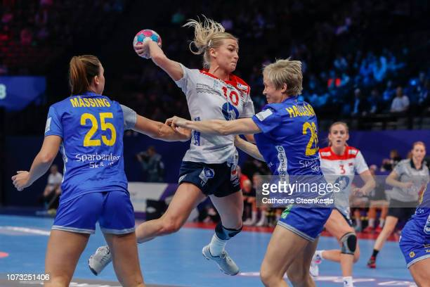 Stine Bredal Oftedal of Norway shoots the ball against Mikaela Massing and Elin Hellagard of Sweden during the EHF Euro match for the classification...