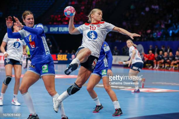 Stine Bredal Oftedal of Norway shoots the ball on target against Carin Stromberg of Sweden during the EHF Euro match for the classification 56...