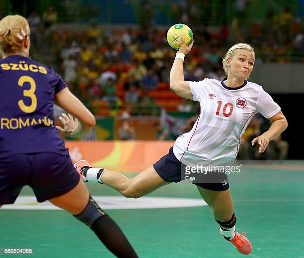 Stine Bredal Oftedal of Norway takes a shot as Gabriella Szucs of Romania defends on Day 9 of the Rio 2016 Olympic Games at the Future Arena on...