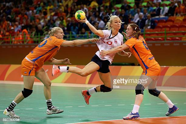 Stine Bredal Oftedal of Norway takes a shot under pressure of Danick Snelder and Laura van der Heijden of Netherlands during the Women's Handball...