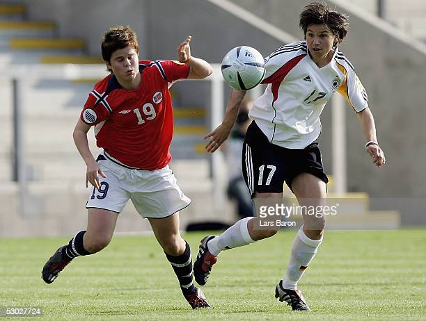 Stine Frantzen from Norway in action with Ariane Hingst from Germany during the UEFA Women's Championship group B preliminary match between Germany...