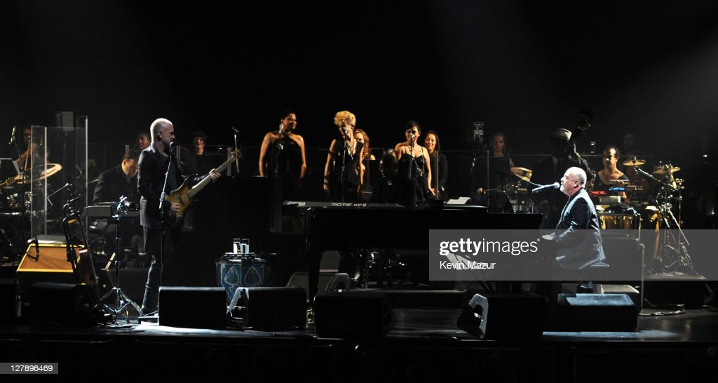 Sting and Billy Joel perform on stage during