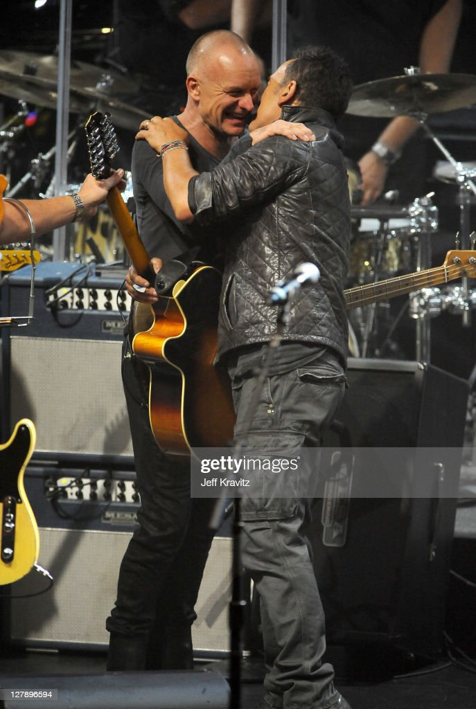 Sting and Bruce Springsteen performs on stage during