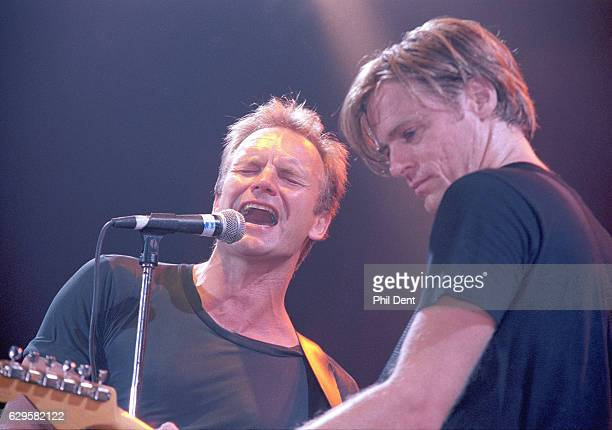 Sting and Bryan Adams perform on stage 1995