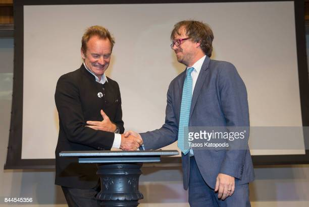 Sting and John Troutman curator of American Music sign the deed of gift for objects being donated at the Smithsonian National Museum Of American...
