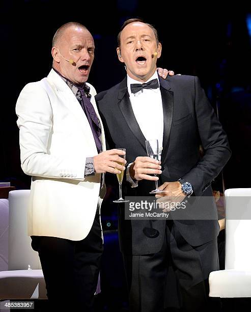 Sting and Kevin Spacey perform during the 25th Anniversary Rainforest Fund Benefit Concert at Carnegie Hall on April 17 2014 in New York City