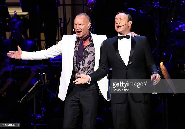 Sting and Kevin Spacey perform onstage at The 2014 Revlon Concert For The Rainforest Fund at Carnegie Hall on April 17 2014 in New York City