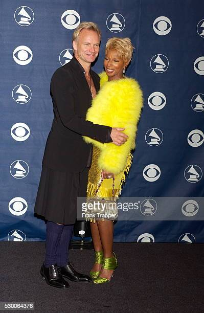 Sting and Mary J Blige in the press room at the 46th annual Grammy Awards