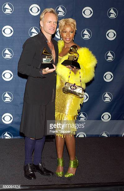 Sting and Mary J Blige in the press room with their award for Best Pop Collaboration With Vocals at the 46th annual Grammy Awards