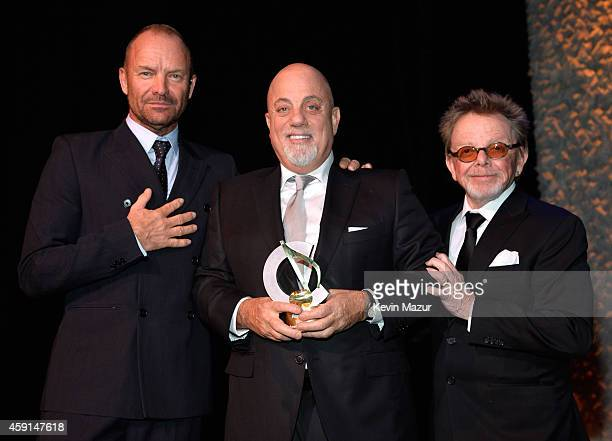 Sting Billy Joel and President and Chairman of ASCAP Paul Williams pose onstage at the ASCAP Centennial Awards at Waldorf Astoria Hotel on November...