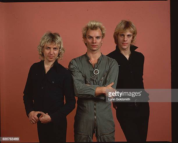 Sting center in flight suit flanked by Stewart Copeland and Andy Summers